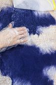 Workshop Of Hand Making A Fleece Gloves From Blue Merino Sheep Wool Using Wet Felting Process - Craf poster