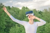 Enjoying New Technology. Pretty Girl In Virtual Reality Headset. Cute Girl Play In Simulated Environ poster