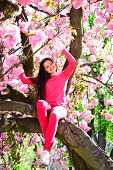 Her Individual Fashion Sense. Fashionable Young Lady On Flowering Tree. Fashion Clothing For Spring. poster