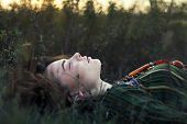 Portrait Of Beautiful Hippie Girl Lying On The Grass. Relax And Beauty Concept poster