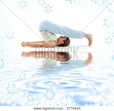 Halasana Plow Pose On White Sand