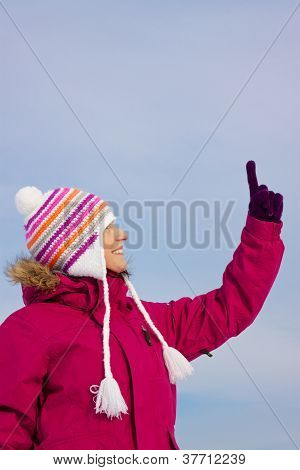Girl In Witer Clothes Pointing Upwards