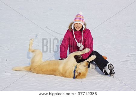 Girl On Ice Skates Playing With Dog