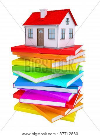A Small House On A Stack Of Colorful Books