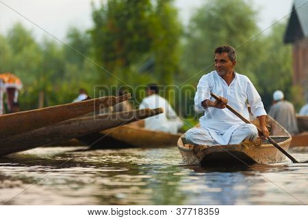 Dal Lake Floating Market Man Calmly Rowing