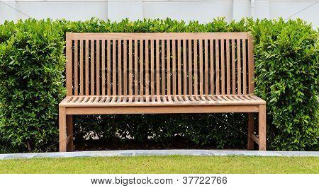 Wooden Bench In Green Bush