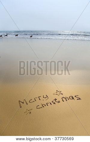 Feliz Natal, escrito na areia