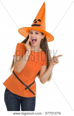 Young Woman In Halloween Hat Whispering And Pointing On Copy Spa