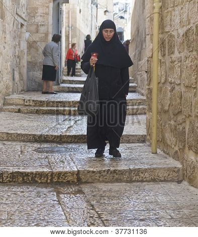Nun Holds Candle