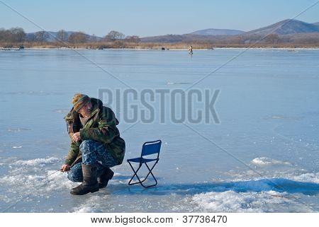 Man On Winter Fishing
