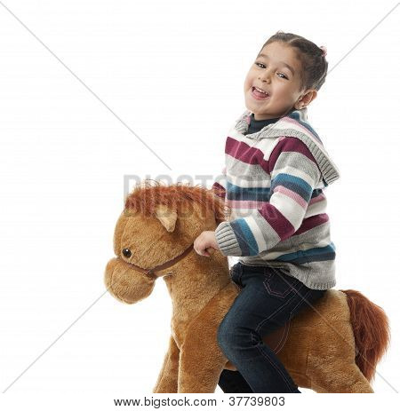 Happy Girl On Rocking Horse