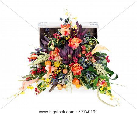 A Colorful Floral Arrangement Of Roses, Lilies, Freesia And Irises In A Wooden Chest, Isolated On Wh