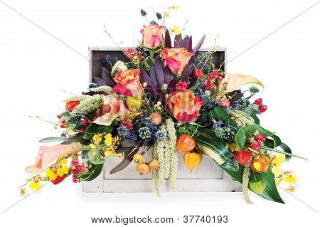 Colorful Floral Arrangement Of Roses, Lilies, Freesia And Irises In A Wooden Chest, Isolated On Whit