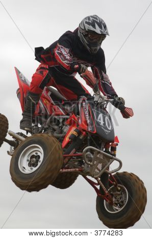 Atv Motocross Rider Over A Jump