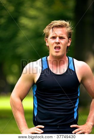 Young Runner Looking Exhausted