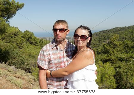 Couple On Valley Background