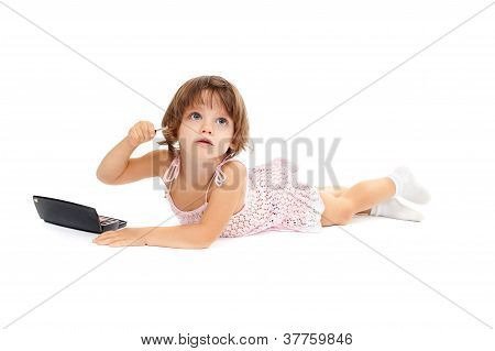 Cute Little Girl Is Applying Mascara