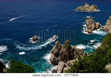 Rocky Sea Coast With A Boat