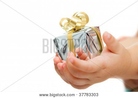 Babies Hands Holding Small Present.