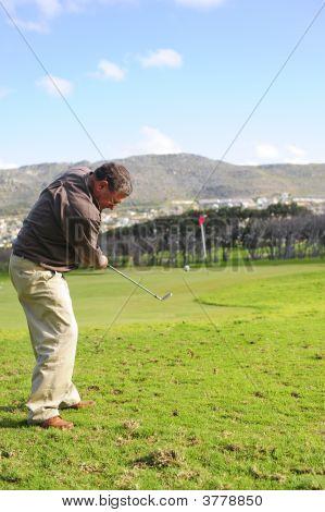Senior Golfer In Action