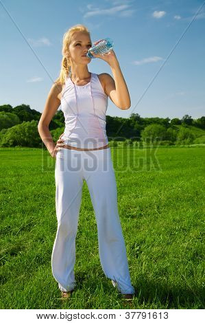 Beautiful Young Woman Drinks Water