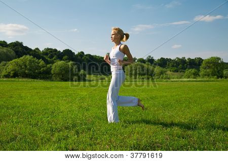 Beautiful Young Woman Running Outdoors