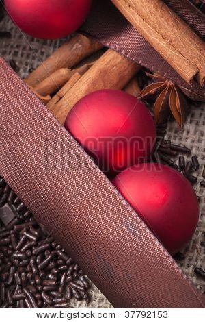 red Christmas tree ornaments and cinnamon