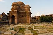 foto of empty tomb  - Graves surround the Tomb of Budshah a popular tourist attraction in Srinagar Kashmir India - JPG