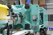 picture of thermoplastics  - Injection moulding machine used for the forming of plastic parts using plastic resin and polymers - JPG