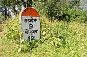stock photo of mahadev  - Milestone landmark indicating 9 kilometers to Mahadev - JPG