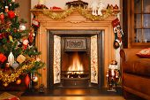 stock photo of cozy hearth  - Christmas fire place in a living room - JPG