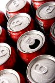 stock photo of groping  - Cans of ice cold red soda pop in aluminum cans forming a background - JPG