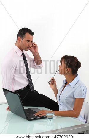 Flirtatious business duo