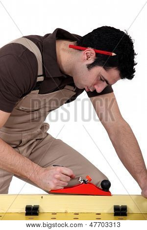 Laborer sawing