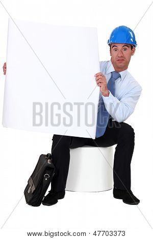 Engineer holding a blank sign