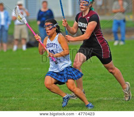 Girls Hs Varsity Lacrosse Shot On Goal