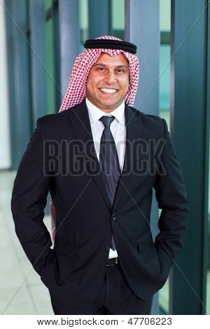 handsome arab businessman in black suit