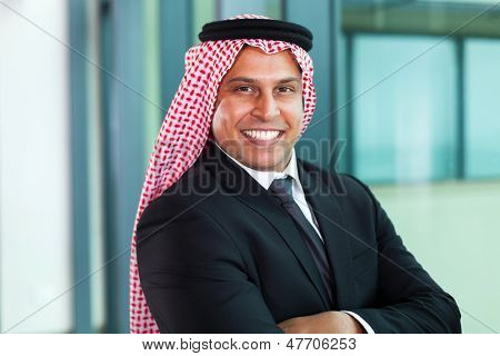 smiling middle eastern businessman in office