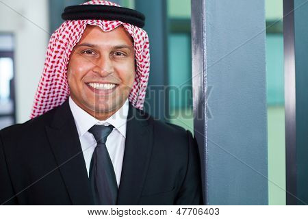 cheerful arabian businessman in modern office