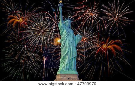 Colorful fireworks on black sky with statue of liberty