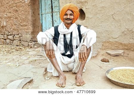 Portrait of old man on the doorstep of his dwelling in Mandu.
