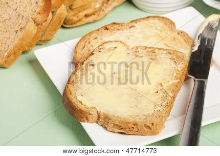 Bread And Butter On Square White Plate