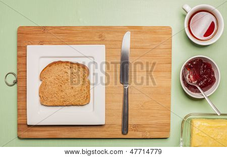 Sliced Brown Bread On Square Plate With Herbal Tea
