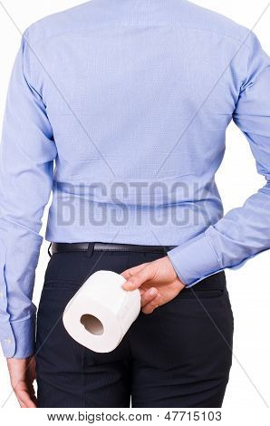 Businessman holding toilet paper behind his back.