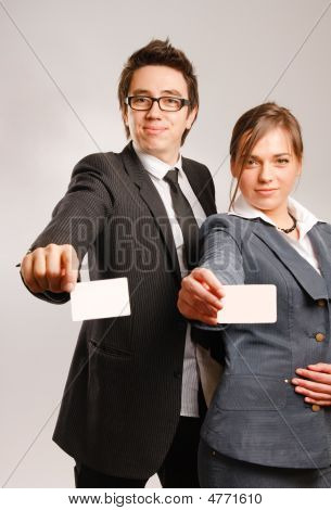 Business Partners Holding Blank Cards