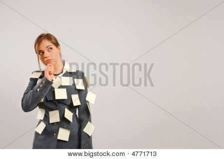 Young Businesswoman With Stickers On Her Suit