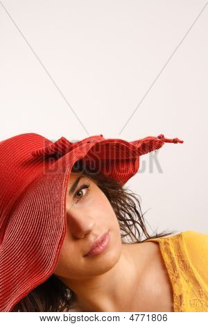 Portrait Of Attractive Beautiful Young Woman Wearing Red Hat