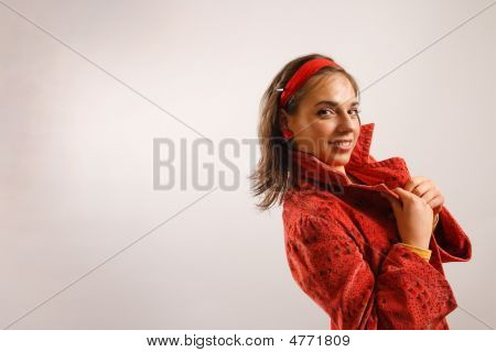 Portrait Of Attractive Beautiful Young Woman Wearing Red Jacket