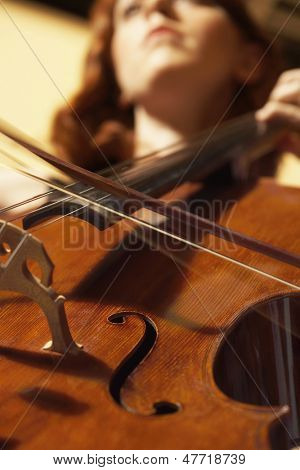 Detail low angle shot of a woman playing cello