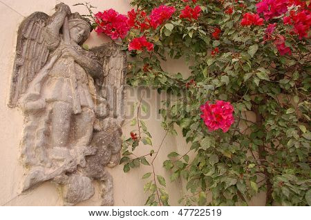 Angel wall with vines in San Miguel de Allende